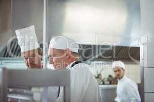 Chefs preparing food in the commercial kitchen