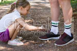 Girl tying her grandfathers shoe laces
