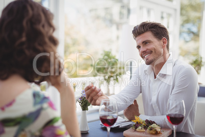 Handsome man offering engagement ring to woman
