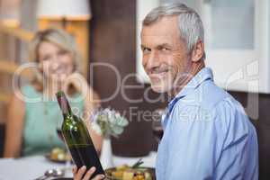 Mature couple having meal and red wine