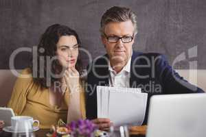 Businessman and colleague working over laptop