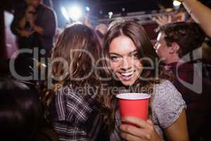 Portrait of happy woman enjoying music festival