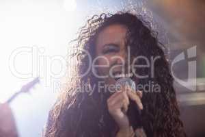 Young female singer performing in nightclub