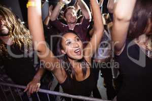 Woman with crowd enjoying at night