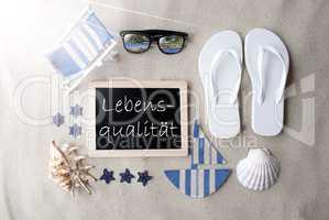 Sunny Blackboard On Sand, Lebensqualitaet Means Life Quality