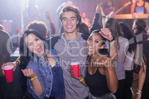 Portrait of cheerful friends at nightclub