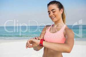Smiling woman looking at wristwatch
