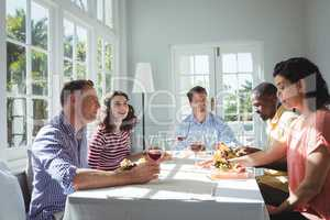 Group of friends interacting while having meal