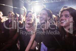 Cheerful people enjoying at nightclub