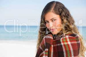 Close up portrait of woman wrapped in blanket
