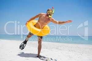 Man with snorkel wearing inflatable ring