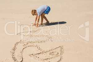 Side view of boy playing with sand