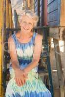 Portrait of senior woman sitting on steps