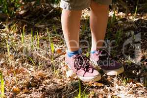 Boy in shoes standing in the forest