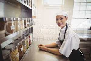 Female chef standing in the commercial kitchen