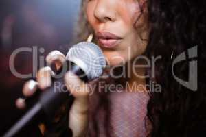 Close up of female singer singing at nightclub