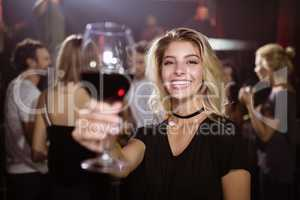 Portrait of smiling young woman holding wineglass