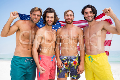 Portrait of male friends holding American flag