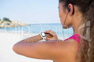 Woman using smart watch while jogging