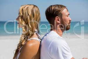 Close up of couple meditating at beach