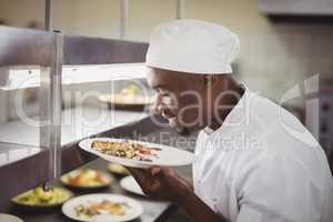 Chef smelling food in commercial kitchen