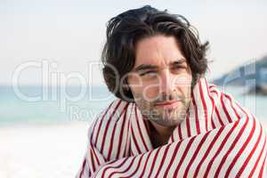 Close up of thoughtful man wrapped in shawl