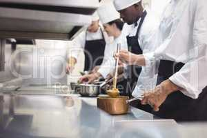 Team of chef preparing food in the commercial kitchen