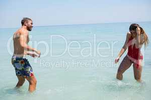 Playful couple enjoying in sea