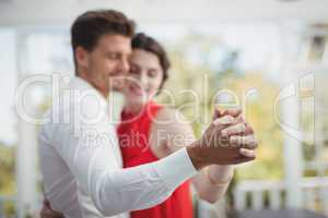 Romantic couple dancing with hand in hand