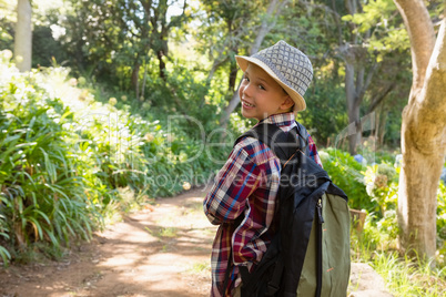 Boy looking behind in the forest
