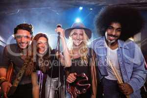 Portrait of performers at nightclub