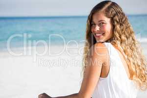 Portrait of happy young woman at beach