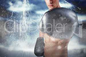 Composite image of portrait of boxer performing boxing stance
