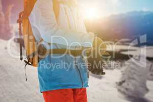 Composite image of midsection of skier wearing gloves
