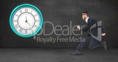 Businessman running late clock mounted on wall