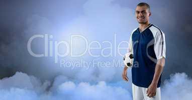 Soccer player smiling against sky