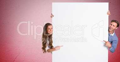 Couple pointing at blank bill board