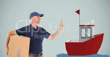 Delivery man holding parcel while pointing at boat