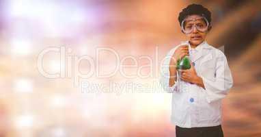 Portrait of boy doing scientific experiment over blur background