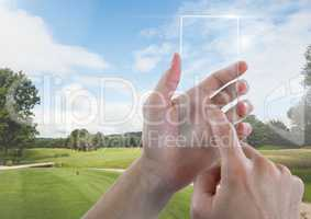 Hand Touching Glass Tablet in nature park with sky