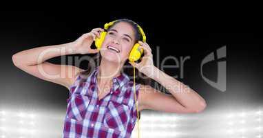 Happy woman listening to songs on headphones