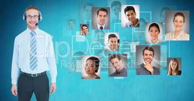 Smiling male customer care representative standing by flying portraits