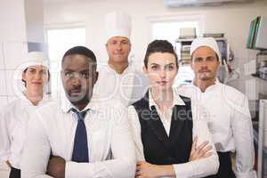 Restaurant manager with his kitchen staff