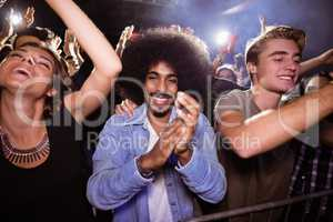 Portrait of man amidst crowd at nightclub