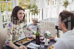 Romantic couple interacting while having meal