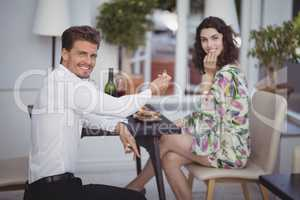 Portrait of man offering engagement ring to woman