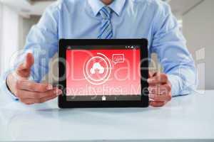 Composite image of businessman showing digital tablet