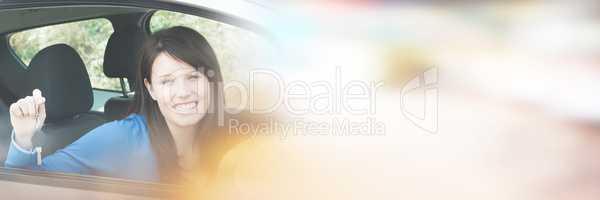 Teenage girl sitting in car holding keys
