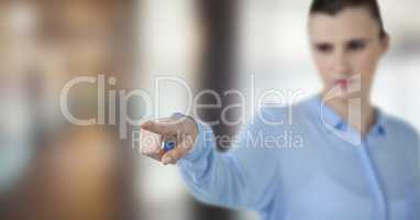 Businesswoman pointing over blurred background