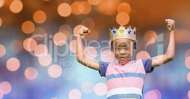 Portrait of kid wearing crown while flexing muscles